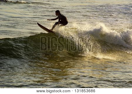 Boy surfing at Arpoador beach in Ipanema
