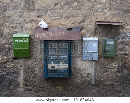 FEODOSIA,UKRAINE - SEPTEMBER 13,2012 - Old mailboxes on the wall.