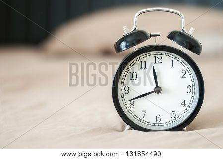 black alarm clock with background soft brow