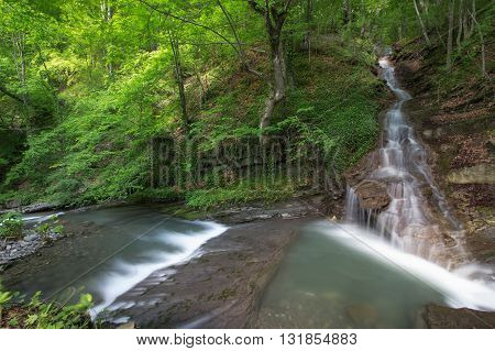 beautiful waterfall in green forest in mountain, Bulgaria