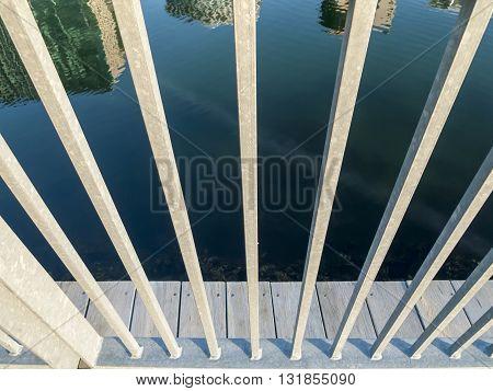 Reflection of Boston waterfront skyline through railing