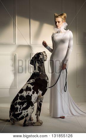 Elegant fashionable woman posing with a big dog