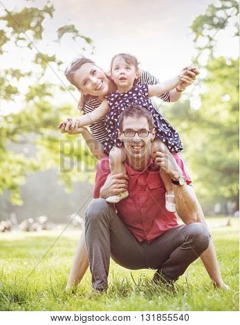 Happy family hugging in a park