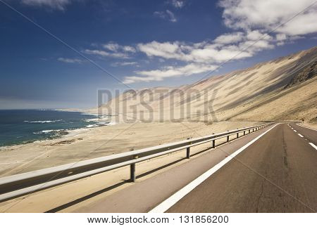 highway in chilean desert through the coast line near the pacific ocean