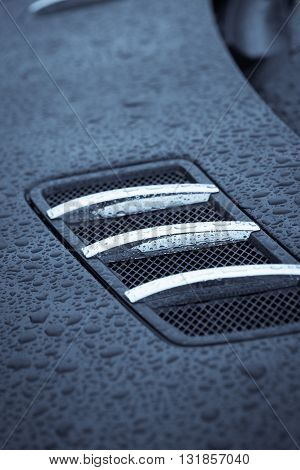 Close-up image of an air intake scoop on a car.