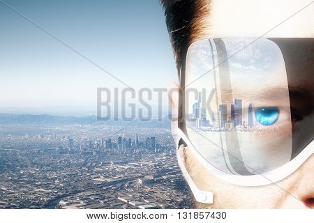 Closeup of man's face wearing smart glass with city reflection and cityscape background