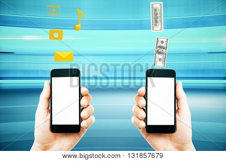 Mobile marketing and money transfer with male hands holding smart phones with blank white screens on abstract blue background. Mock up 3D Rendering