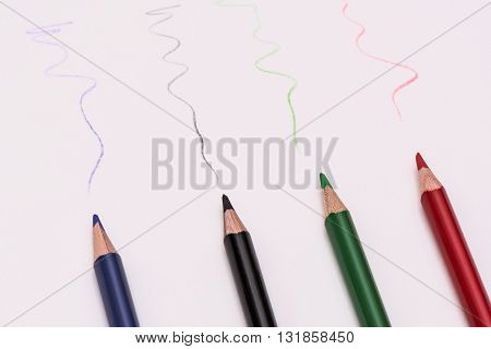 Four Colour Pen Lay On White Background