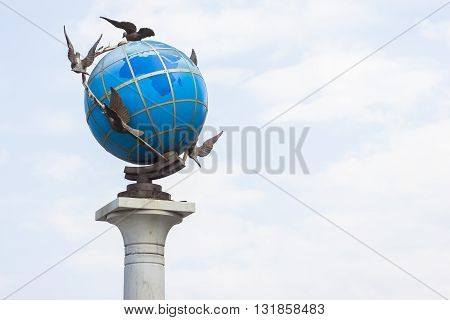 Earth blue globe with doves around it