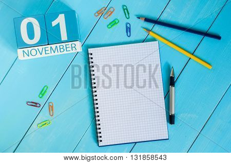 November 1st. Image of november 1 wooden color calendar on blue background. Autumn day. Empty space for text.
