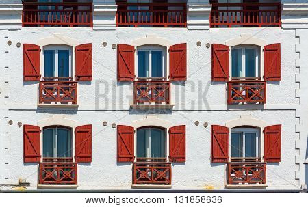 Typical buildings of Basque country in a street of Saint-Jean de Luz - Ciboure. Aquitaine France.