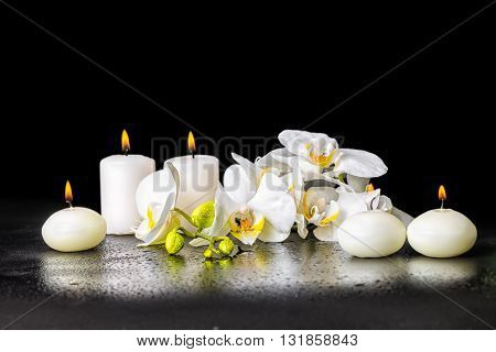 Beautiful Spa Background Of Blooming White Orchid Flower, Phalaenopsis With Drops And Candles Is Iso