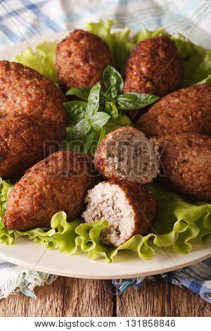 Arabic Kibbeh With Bulgur And Pine Nuts On A Plate Macro. Vertical