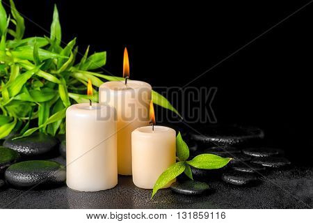 Spa Concept Of Twigs Bamboo With Dew And Candles On Zen Basalt Stones, Close Up