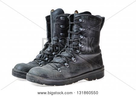 Pair of black leather army shoes on a white background