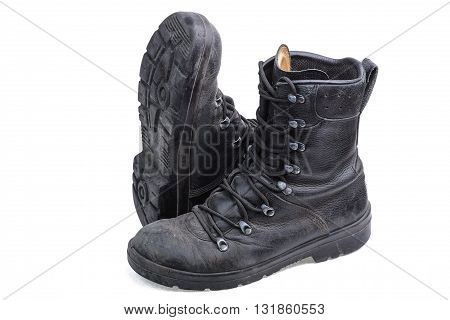 Pair of army boots on white background outsole top