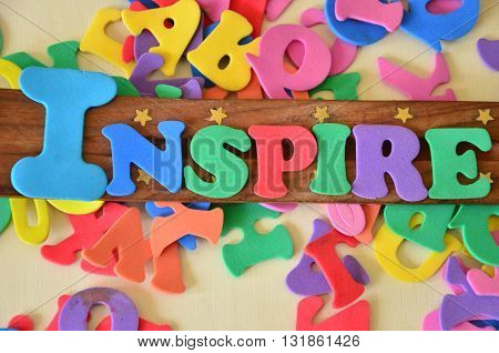 inspire word on a  abstract colorful background