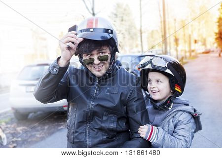 Father And Son Biker Paused During A Trip