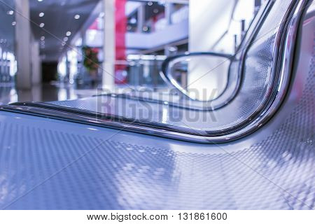 Metal bench for relaxing in modern shopping center interior sunlight