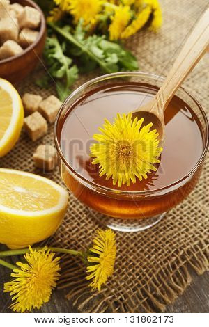 Jam of dandelions on the wooden table