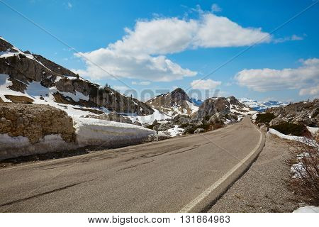 A road in a high mountain pass in the Dolomites