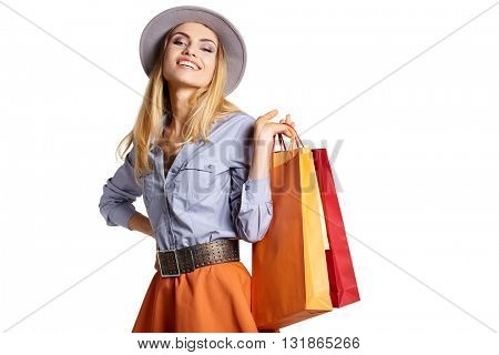 Portrait of happy smiling woman hold shopping bag. Female model isolated studio background.