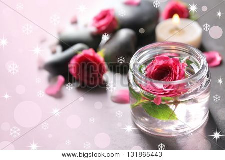 Spa composition of candles, stones and flowers with snow effect