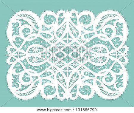 White lacy doily with flowery pattern on a turquoise background