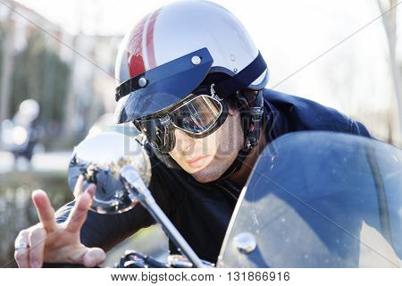Portrait Of Young Biker Riding His Motorcycle