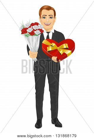 Handsome man holding bouquet of flowers and heart shape present isolated over white background