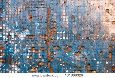 square mosaic on old wall. background of the obsolete mosaic tiles