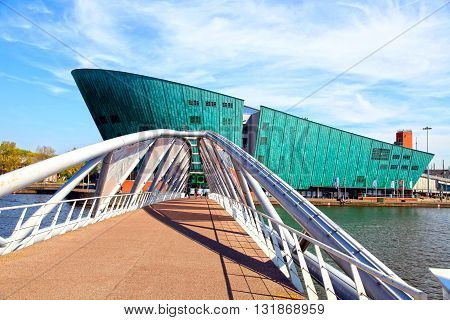 AMSTERDAM, NETHERLANDS - MAY 6, 2016: Science Center NEMO designed by Renzo Piano (1997) - largest childrens science educational museum knowledge institute and center of tourism in Amsterdam Netherlands.