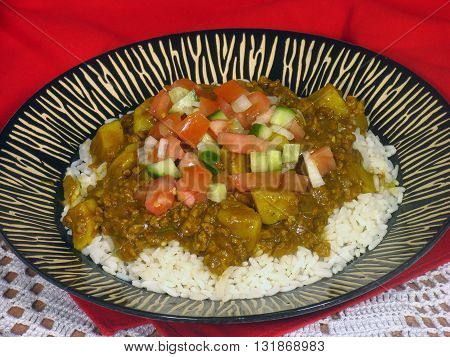 Curried Mince And  Rice With A Tomatoe And Cucumber Salad On Top 01
