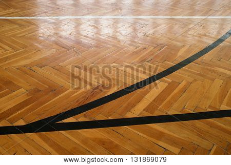 Black Lines In Hall. Worn Out Wooden Floor Of Sports Hall With Colorful Marking Lines
