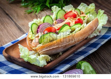 Homemade Sandwich On A Wooden Table.