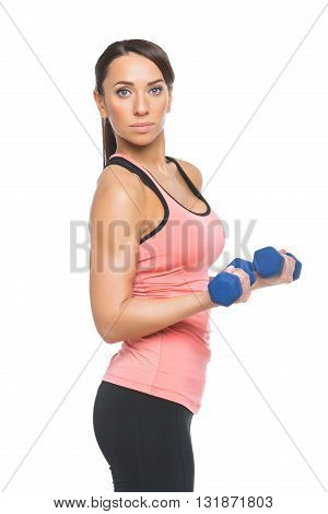 Beautiful sporty woman in sportwear making exercise with blue dumbbells. Isolated over white background.