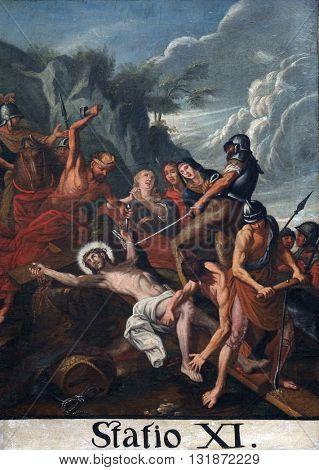KOTARI, CROATIA - SEPTEMBER 16: 11th Stations of the Cross, Crucifixion: Jesus is nailed to the cross, Church of Saint Leonard of Noblac in Kotari, Croatia on September 16, 2015.