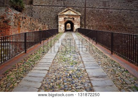 entrance gate and  bridge to the castle in Savona