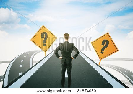 Success concept with question mark signs and thoughtful businessman standing on highway road leading to bright sky. 3D Rendering