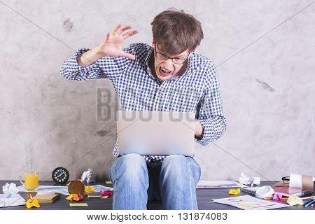 Man About To Hit Laptop