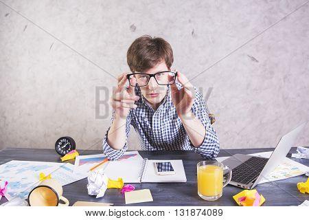 Businessman Looking Through Eyeglasses