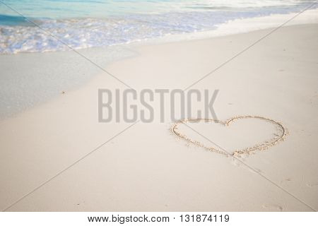 heart on sand and summer sea with sky