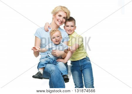 Young beautiful happy mother with two sons. Isolated over white background. Copy space.