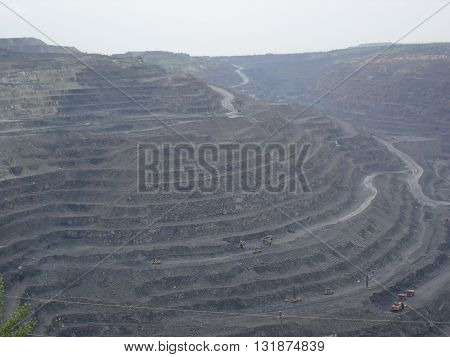 Surface ironstone mining (open pit quarry) .