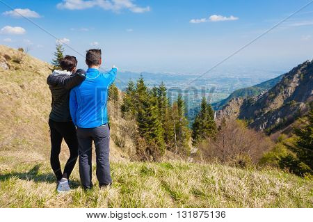 Young Couple On Top Of A Mountain