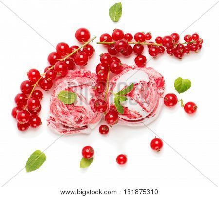 Redcurrant and vanilla marble ice cream and fresh berries isolated on white background view from above.