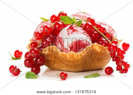 Vanilla and redcurrant marble ice cream in a wafer bowl decorated with mint and fresh berries isolated on white background.