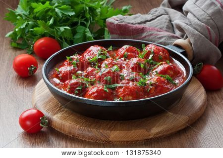 Delicious homemade chicken or turkey meatballs with rice vegetable in tomato sauce