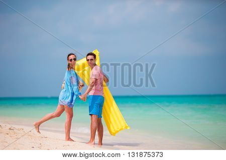 Young happy couple have fun during beach vacation