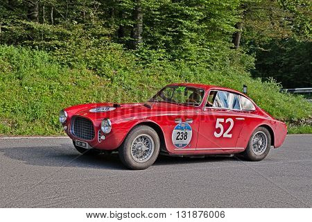 PASSO DELLA FUTA (FI) ITALY - MAY 21: driver and co-driver on a vintage sportscar Ferrari 212 Inter Coupé Vignale (1952) in classic car race Mille Miglia on May 21, 2016 in Passo della Futa (FI) Italy